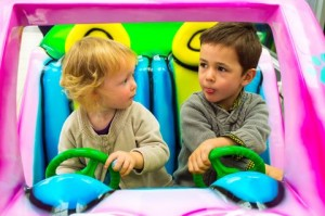 http://www.dreamstime.com/royalty-free-stock-photo-boy-girl-driving-car-adorable-kids-together-small-each-has-separate-steering-wheel-choosing-direction-image38869085